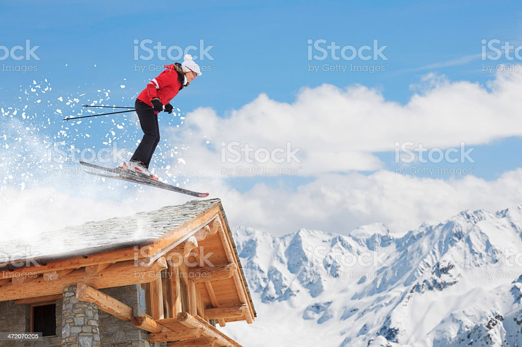 Snow skier, jumping at high speed, mountain ski resort in the snowy...