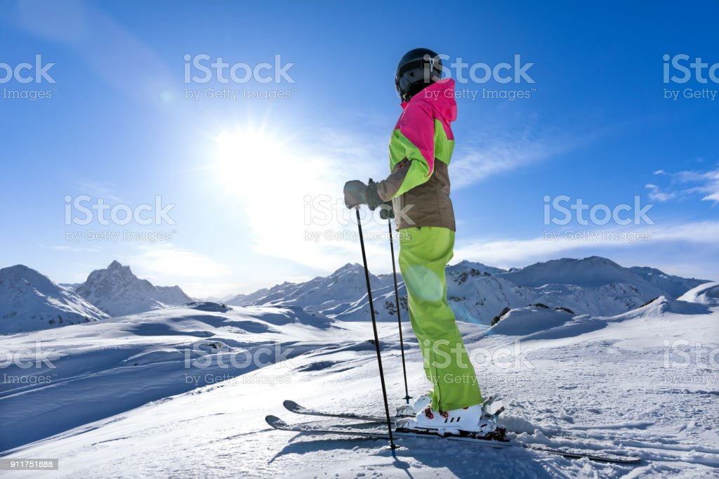 young sexy woman is doing winter sport in the snowy moountains. she...