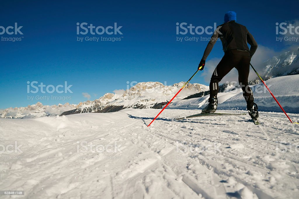 skiing winter sports athlete in snow covered mountains of Lavaze stock photo