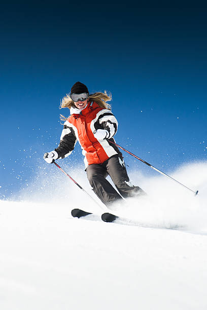 Skiing woman on modified piste stock photo