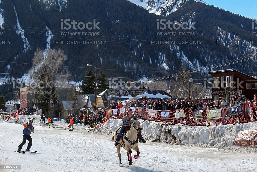 Skijoring Competition in a Mountain Town stock photo