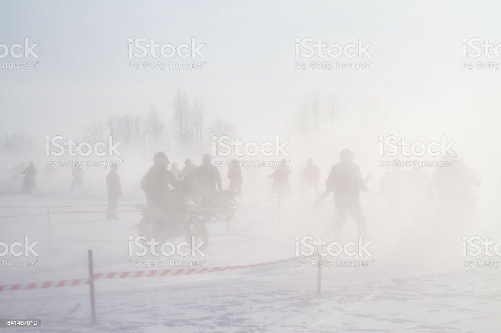 Ski-joring people on a frozen lake stock photo