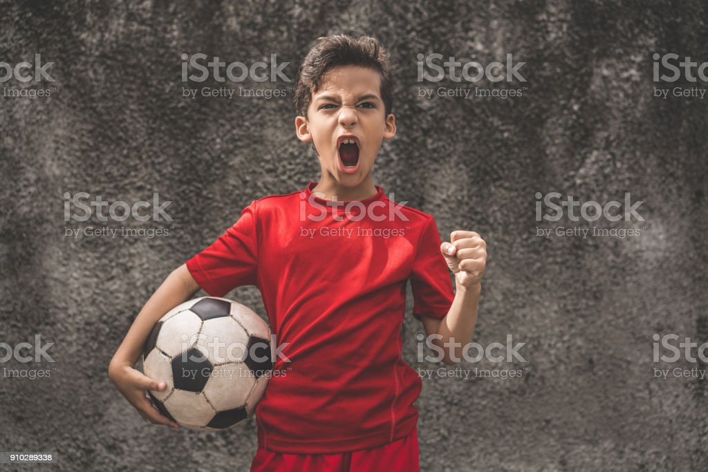 Skilled boy playing football stock photo