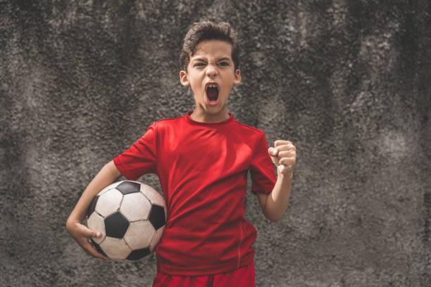 Skilled boy playing football stock photo