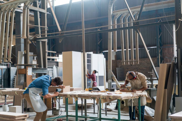 Skilled carpenters making furniture in factory stock photo