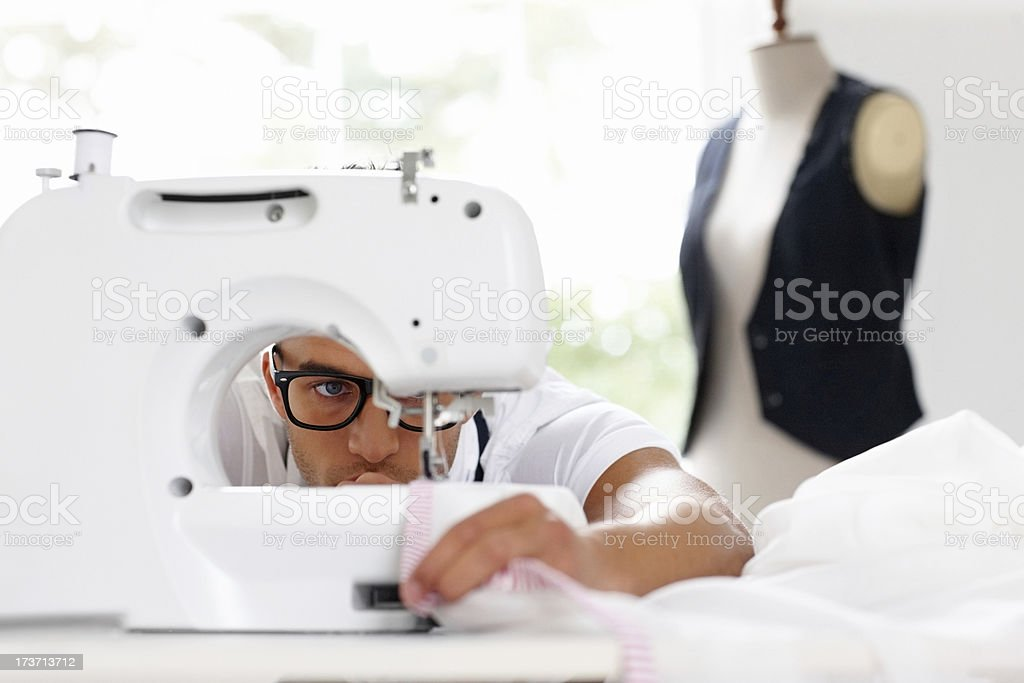 Skilled dressmaker working on sewing machine royalty-free stock photo