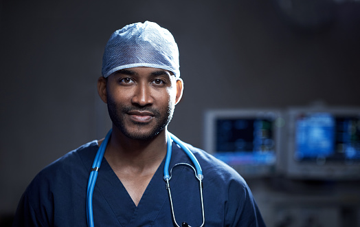 Portrait of a confident young surgeon standing in an operating room