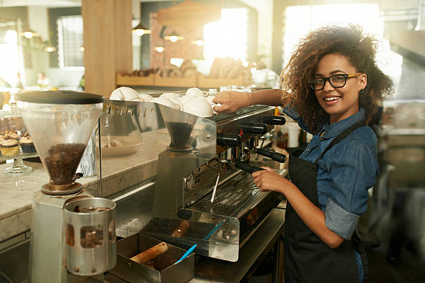 skilled in the art of making coffee - barista stock photos and pictures