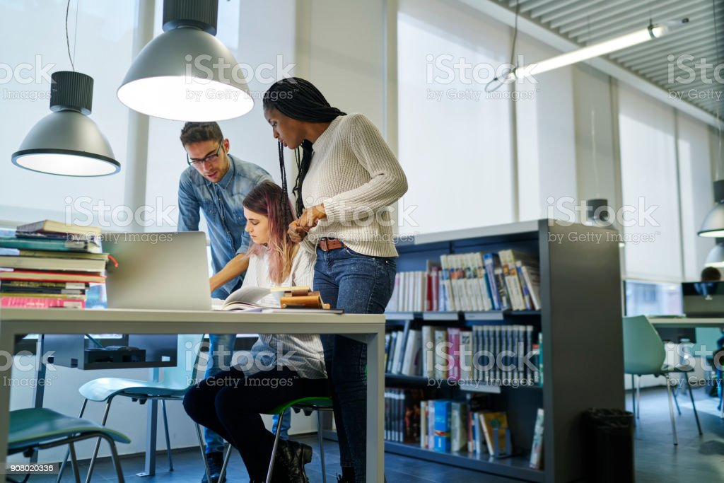 Skilled male and female colleagues working together discussing ideas and opinions for startup project, international students preparing for quality control testing spending time in university library stock photo