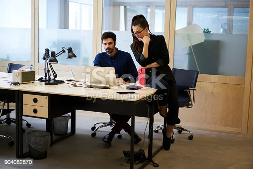 905130626 istock photo Skilled male and female employees of media marketing corporation developing advertising campaign for web store site using application on laptop for creating promotional video collaborating in office 904082870