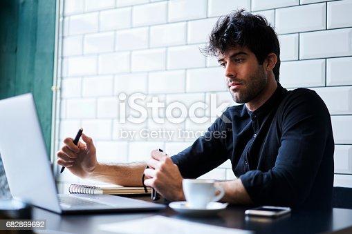 istock Skilled male copywriter 682869692
