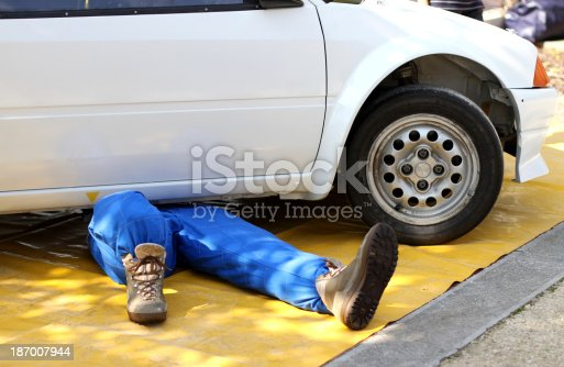 istock skilled mechanic with the suit 187007944