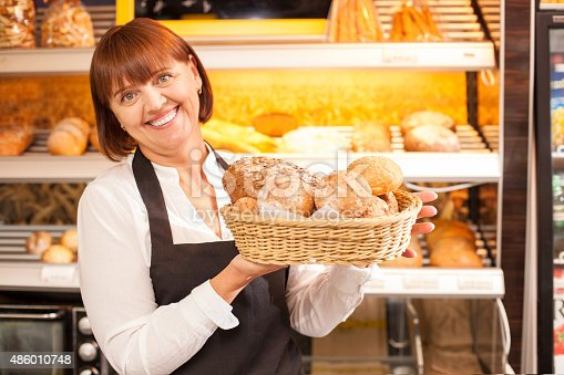 istock Skilled saleswoman is presenting baked products 486010748
