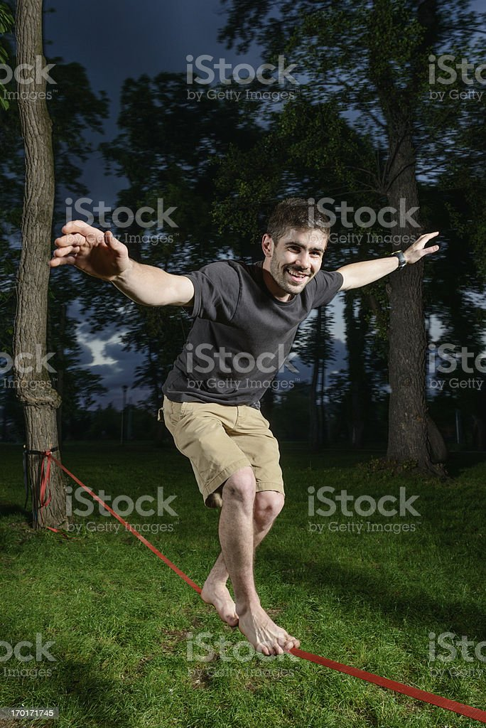 Skilled tightrope walker stock photo