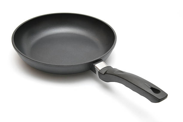 Skillet frying pan on white background stock photo
