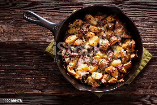 Roasted Potatoes with Bacon (or Pancetta) and Melted Cheese in a Cast Iron Skillet.
