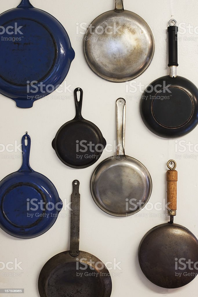 Skillets Hanging on a Wall stock photo