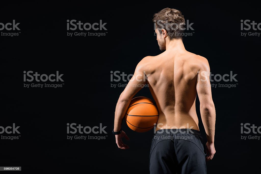 Skillful basketball player posing with equipment royalty-free stock photo