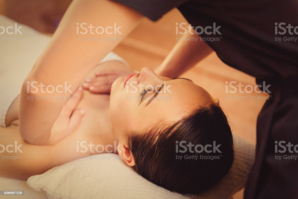 Skillful beautician massaging female body stock photo