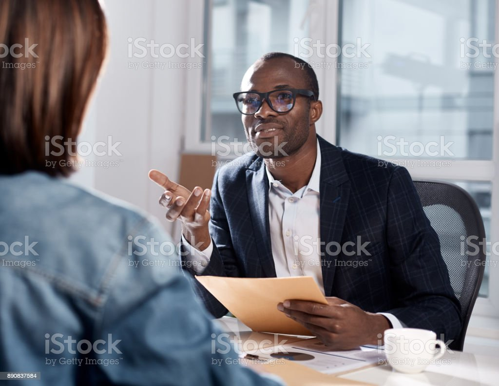 Skillful coworkers are discussing important project stock photo