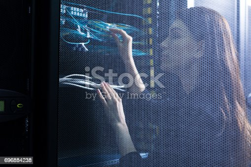 istock Skillful female engineer checking wires 696884238
