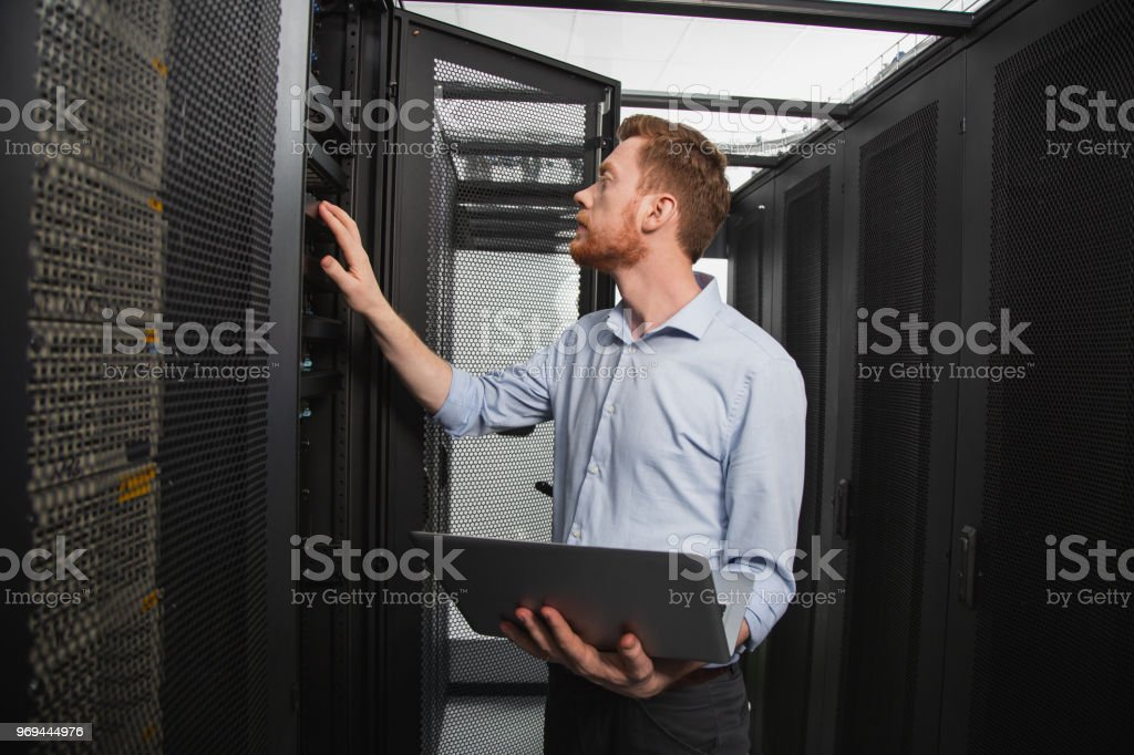 Skillful IT technician establishing connection - Royalty-free Accessibility Stock Photo