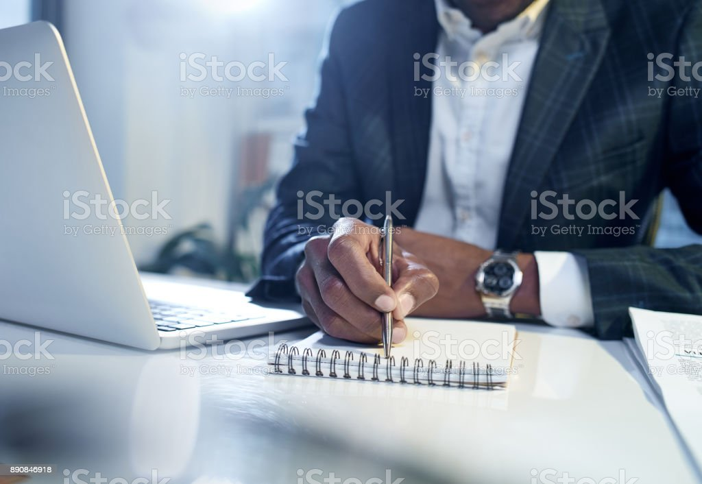 Skillful man is writing in his diary stock photo