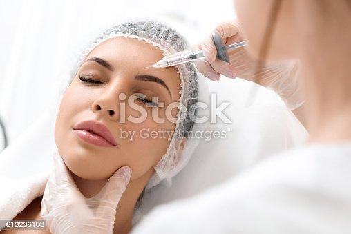 istock Skillful surgeon rejuvenates human skin 613236108