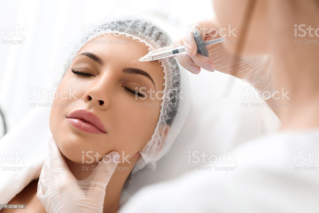 Skillful surgeon rejuvenates human skin stock photo