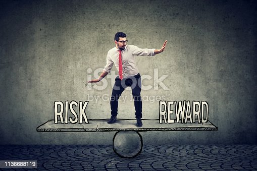 istock Skillful young business man balancing between reward and risk 1136688119