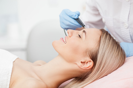istock Skillful young cosmetologist is treating her patient 503239670