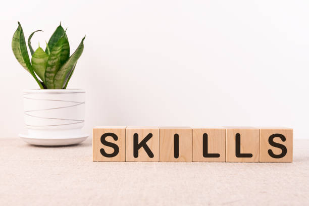 Skills Word Written In Wooden Cube on a light background stock photo