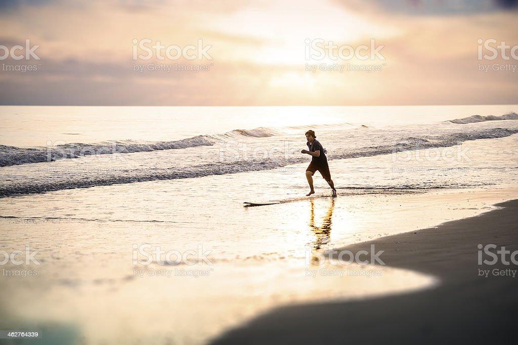 Skim boarder at the beach stock photo