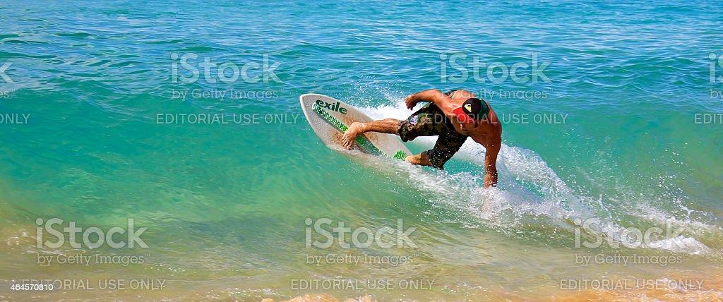Skimboarding in Hawaii stock photo