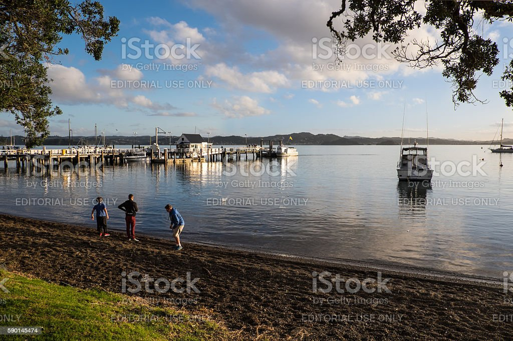 Skimming stones at Russell, New Zealand, NZ stock photo