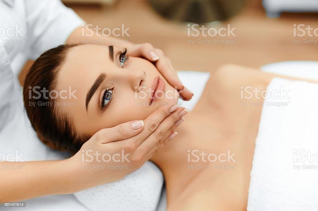 Skin, Body Care. Woman Getting Beauty Spa Face Massage. Treatmen stock photo