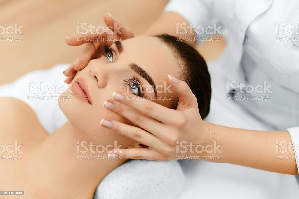 Skin, Body Care. Woman Getting Beauty Spa Face Massage. Treatmen stock photo