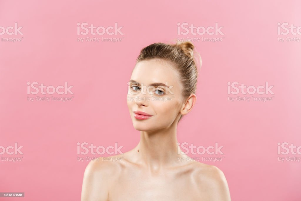 Skin Care Concept - Charming young caucasian woman with perfect makeup photo composition of brunette girl. Isolated on pink background with Copy Space. stock photo