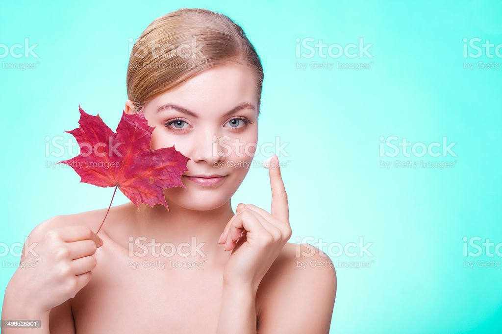 Skin care. Face of young woman girl with leaf cream royalty-free stock photo