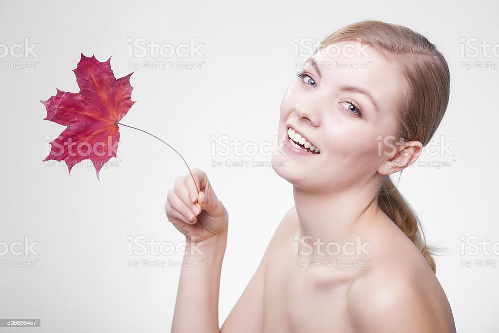 Skin care. Face of young woman girl with leaf cream stock photo