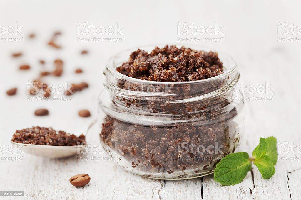 Skin care from body scrub with ground coffee, spa concept stock photo