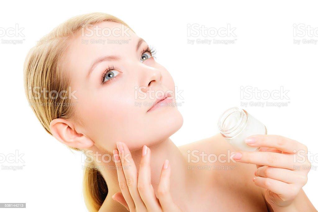 Skin care. Girl applying moisturizing cream stock photo
