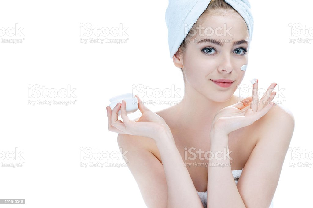 Skin care lady putting face cream stock photo