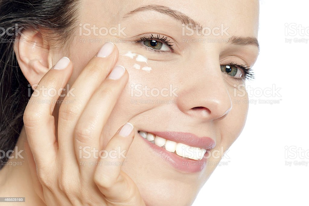 Skin care woman putting face cream stock photo