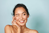 istock Skin care. Woman with beauty face touching facial skin portrait 1254806551