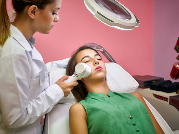 Skin care. Young woman receiving facial beauty treatment. Facial therapy. Anti-aging procedures. tighten stock pictures, royalty-free photos & images