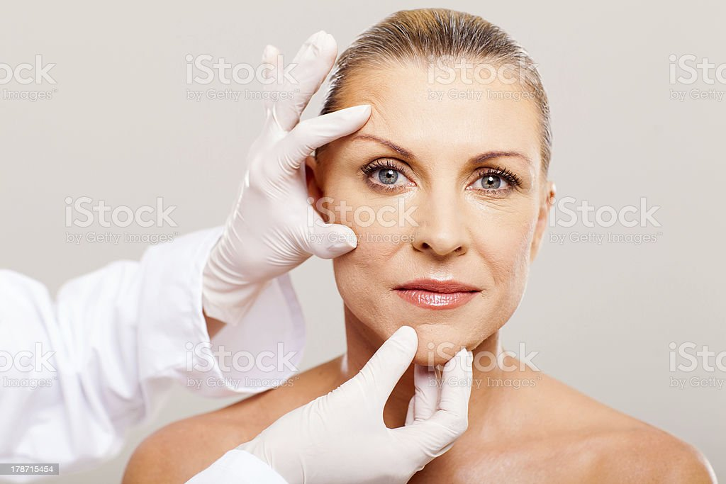 skin check before plastic surgery stock photo
