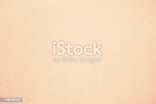 A skin coloured background with frosty drops all over. Textured look as of rain drops sticking to a wall.