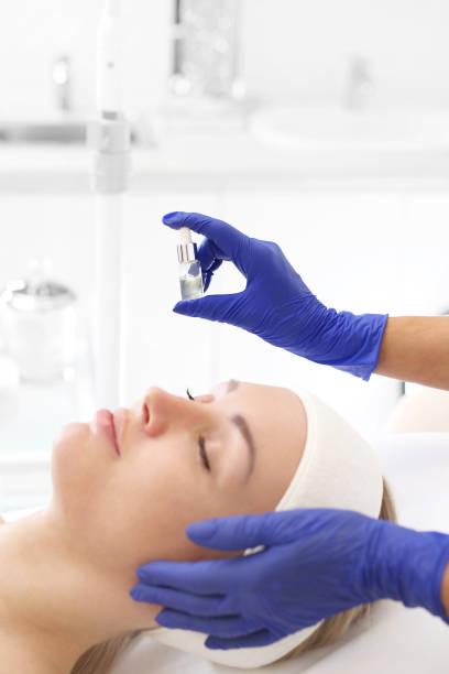 skin exfoliating treatment. - chemical peel stock pictures, royalty-free photos & images