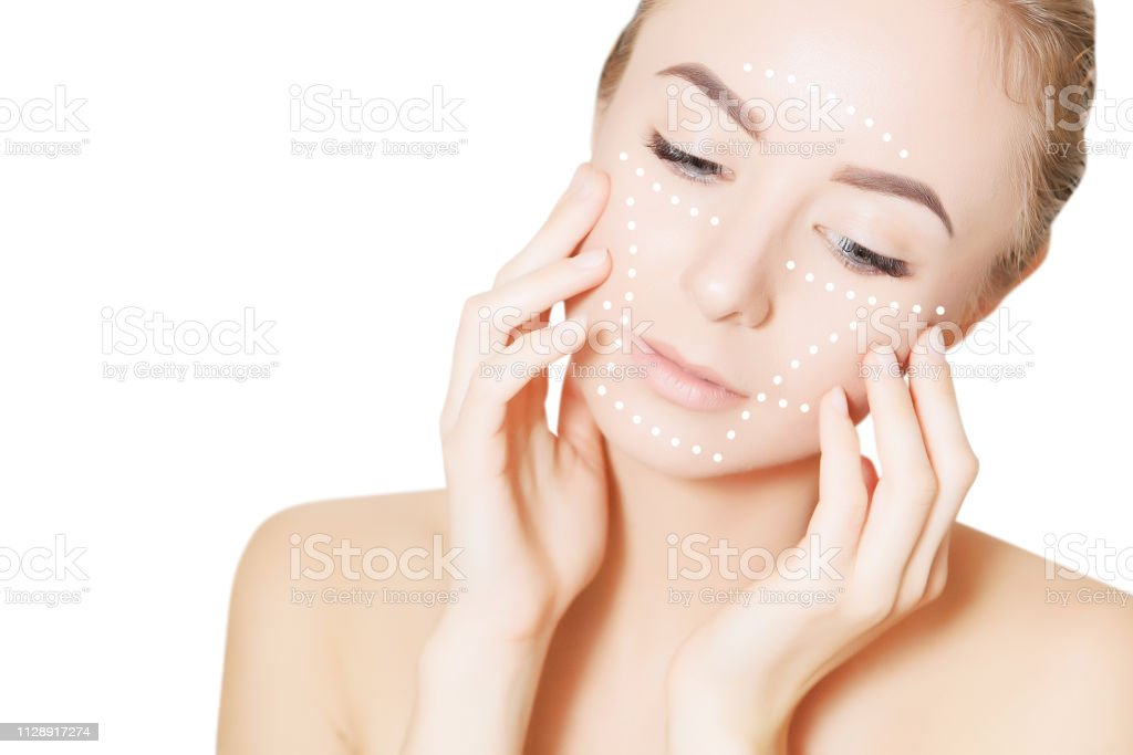 skin plastic surgery concept. Woman face with marks and arrows stock photo